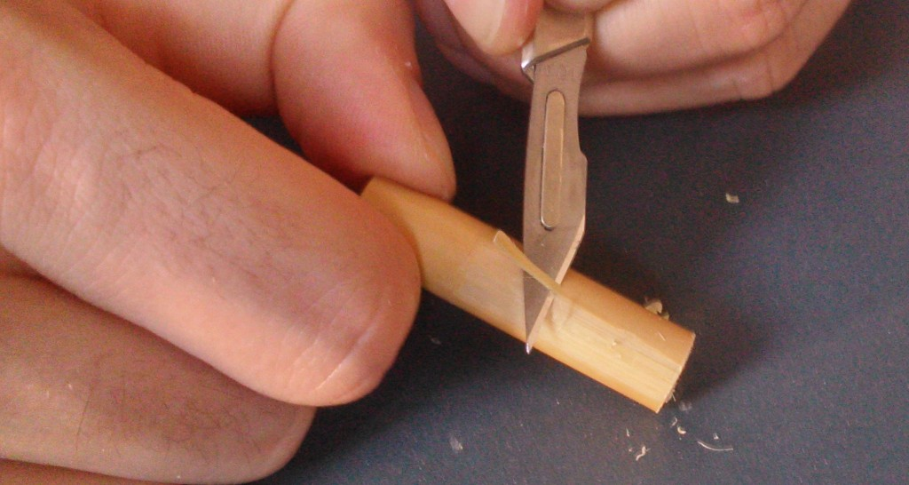Scalpel action removing the bark and golden fibre layer.