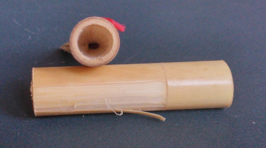 A finished waist interior (above); removing the bark and golden fibre layer (below).